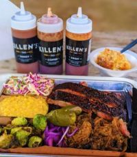 Pork ribs, pulled pork, brisket, sweet corn, cole slaw, Brussels sprouts, pickled onions and jalapenos, and bread pudding