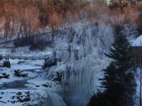 Sun-kissed trees at icy Ausable Chasm