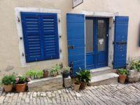 Blue shutters in Motovun, Croatia