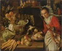 An elaborate kitchen still life with a maid holding a skewer with a piece of meat, with grapes, artichokes and bread in a copper