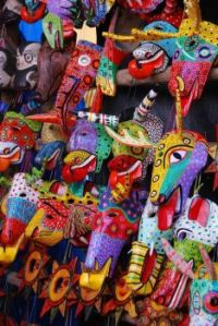 Some of the colorful wooden masks in the Chichicastenango market Guatemala