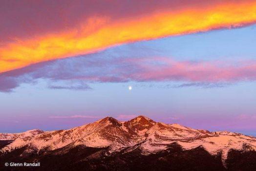 The full moon setting over Longs Peak
