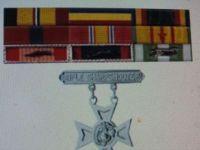 My ribbons and Sharpshooters badge