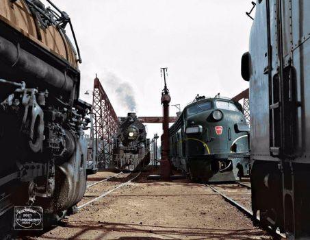 1956 - Pennsylvania Railroad and Santa Fe 2-10-4 steam locomotives with F-unit diesels at Columbus, Ohio