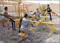 GIs forcing Iraqi kids to see-saw until they talk