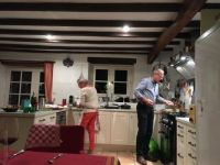 Two people in a French kitchen