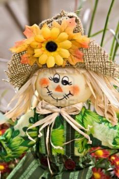 scarecrow with sunflower hat