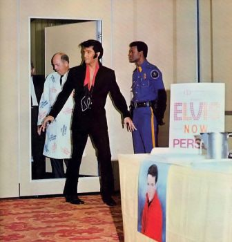 Elvis arrives to meet the press 1969.