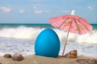 Easter-egg-on-the-beach-under-an-umbrella