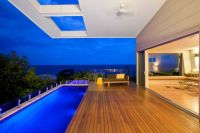 Swimming-Pool-and-Terrace-Design-in-Modern-Coolum-Bays-Beach-House-by-Aboda-Design-Group-