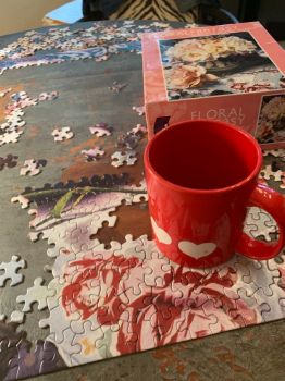 Happiness - a cup of coffee and a puzzle