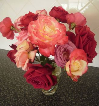 Vase of mixed pink roses