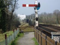 Steam engine and signals on the Bluebell Railway