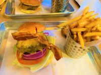 A burger with bacon, cheddar and garlic aioli