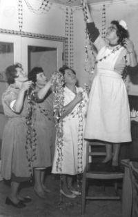 Nurses hanging Christmas decorations