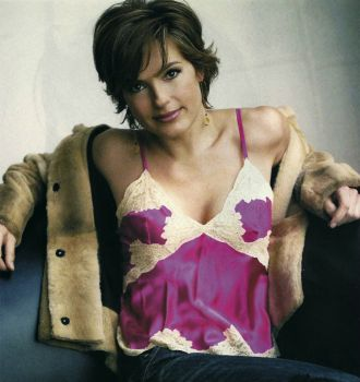 Mariska Hargitay posing for a magazine shoot in 2004. In, you know, a pink silky camisole thing. Yes. (simpler version)