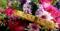 Say it with flowers and scrabble letters