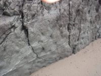 How did this boulder get reverse pimples?  Bandon, Oregon coast