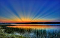 Anticrepuscular rays over lake