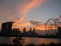 Marina Bay Sands, Singapore (L), Central Business District Office Buildings (C) & The Singapore Flyer (R) at sunset