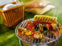 Barbecue picnic with kebabs and corn on the cob