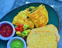 Breakfast eggs quesadilla filled with black beans and crunchy spicy veggies along with cheese