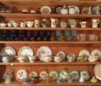 shelf of china at an antiques shop