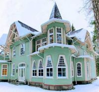 Green + White Victorian House in Winter