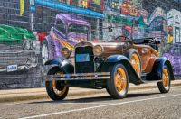 Model A By a Mural in 600 Pieces
