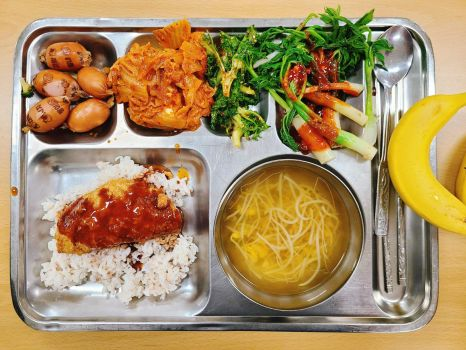 Korean School Lunch of Homemade Cheese Donkasu, Spicy Bean Sprout Soup, and Various Banchan