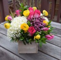 Happiness is....Flowers Arranged in a wooden box.
