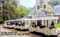 Le Petit Train stopped at an old chruch at the top of a large hill, Honfleur, 2019