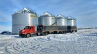 Loading grain a few years ago.