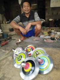 Indonesian Gasing (spintops) and thier maker Yusuf.