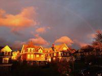 sunset and faint rainbow in Syracuse NY