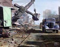 1939 -  Erie steam shovel, Ford truck (blue), Chevrolet truck (red).  Ann Arbor, Michigan.