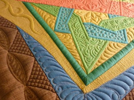 Beautiful quilting.  Love the colors (Quilts of Love)