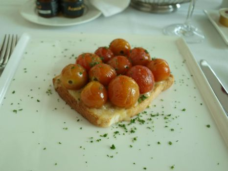 cherry tomatoes and cheese on toast