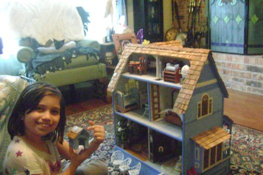 Great-Granddaughter Having Fun with Dollhouse