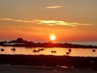Sunset over Cobo Bay