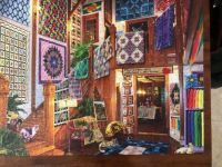 cardboard jigsaw puzzle with quilts and cats