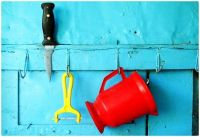 Well loved Kitchen Tools Hanging on a Blue Wall