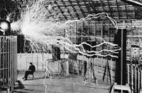 Nikola Tesla in lab with magnifying transmitter