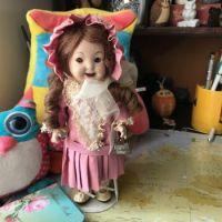 A reproduction, full porcelain  Brigid Google doll.