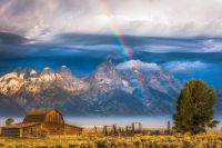 Morning rainbow over Tetons with smoke from wildfires below.