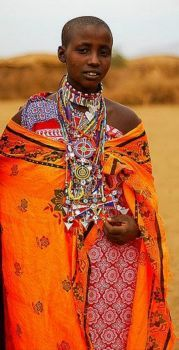 Maasai woman, at the square of her village,