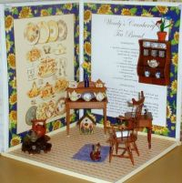Miniature teapot collection displayed in tea book