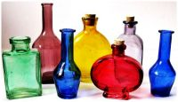 A Collection of Coloured Glass Bottles