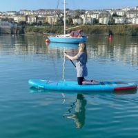 Cousin Paddle-boarding off Flushing, opp Falmouth, Cornwall