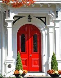 Red door within white facade